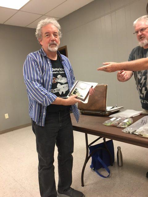 Dave Williamson receives a BAP award at the 2021 July meeting.